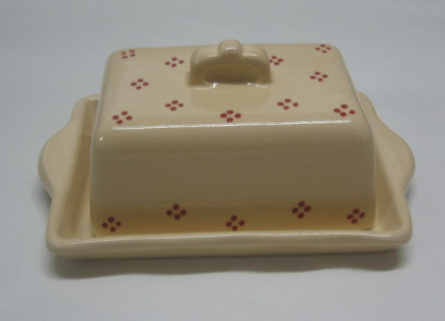 Butter dish cream with red points